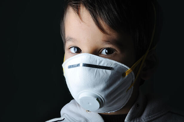 Kid wearing a mask in the dark-3
